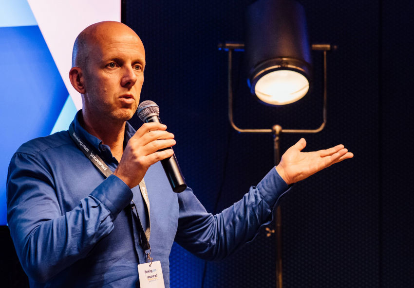 Booking.com's CMO Arjan Dijk gives on-stage insights to business partners